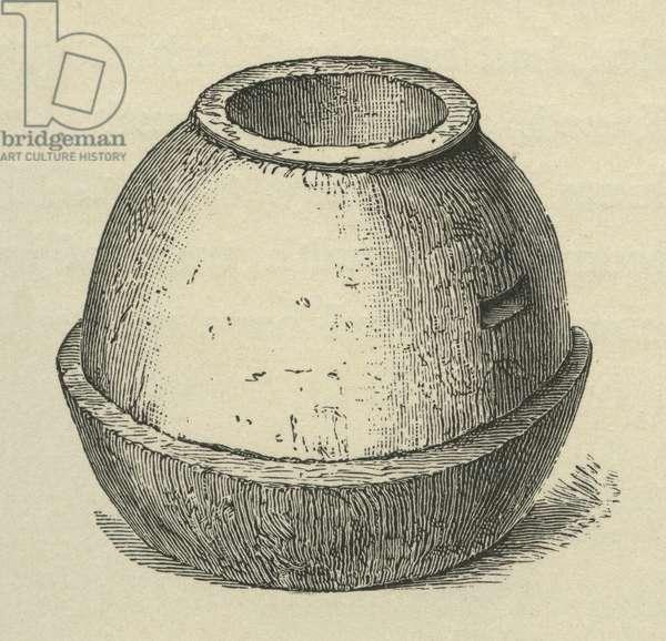 A primitive stone quern