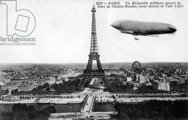 Military airship flying near Eiffel Tower, Paris