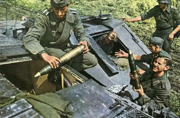 Soldiers load an assault cannon with ammunition. Eastern Front