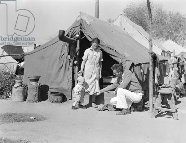 Tom Collins, manager of Kern migrant camp, California, 1936 (b/w photo)