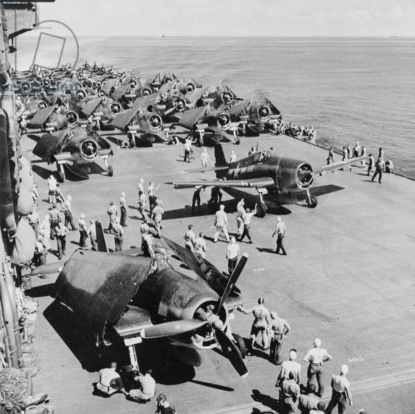 Crewmen Roll Out a Corsair for Take Off from an Aircraft Carrier 1944 (b/w photo)