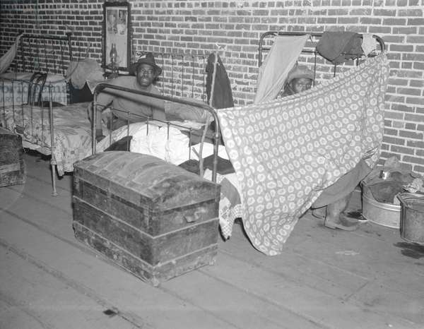 Sick Negroes in the Red Cross temporary infirmary in the camp for flood refugees at Forrest City, Arkansas, 1937 (b/w photo)