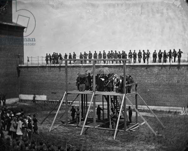 Gen. John F. Hartranft reading the Death Warrant to the Conspirators on the Scaffold, 1865 (b/w photo)