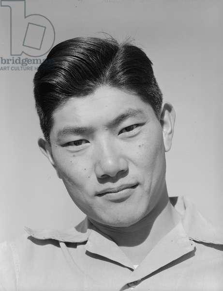Harry (Henry) Hanawa, mechanic, Manzanar Japanese American Internment Camp, California, 1943 (b/w photo)
