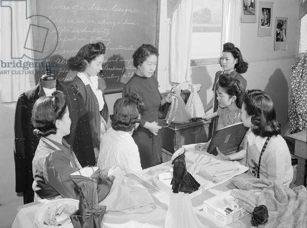 Mrs. Ryie Yoshizawa, teacher, fashion design class, Manzanar Japanese American Internment Camp, California, 1943 (b/w photo)