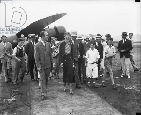 Amelia Earhart arriving in Washington to receive medal from President Hoover, 1932 (b/w photo)