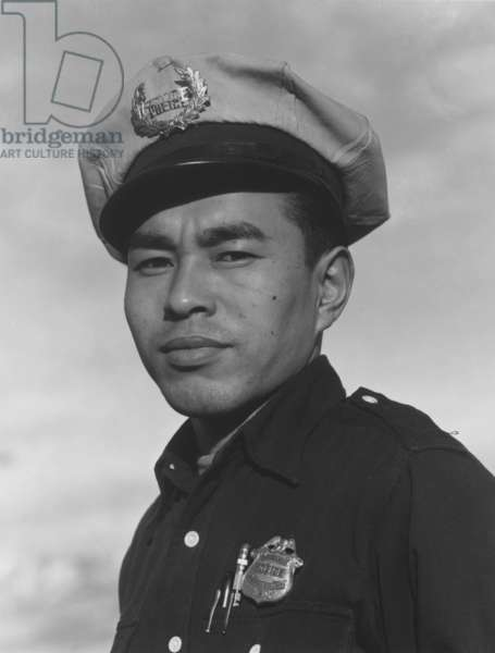 Policeman Sam Bozono at Manzanar, 1943 (b/w photo)
