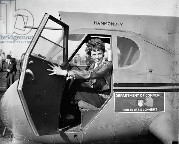 Amelia Earhart, Portrait Sitting in Airplane, USA, c.1936 (b/w photo)
