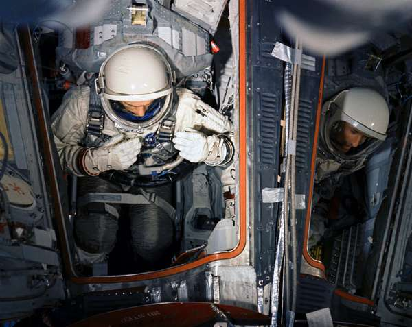 Astronaut Thomas P. Stafford (on left), command pilot, and Eugene A. Cernan, pilot, in Gemini-9 spacecraft in the white room at Pad 19 during a Gemini-9/Agena simultaneous launch demonstration, 10th May 1966 (photo)