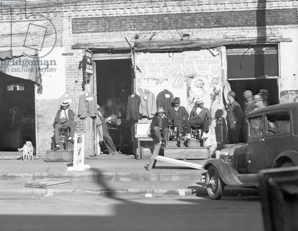 Sidewalk scene in Selma, Alabama, 1935 (b/w photo)