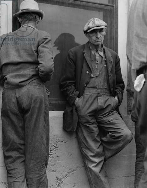 Waiting for twice monthly relief checks at Calipatria, California, 1937 (b/w photo)