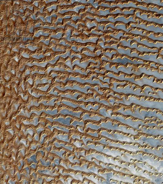 A view from space of sand dunes in Rub' al Khali, 'the Empty Quarter' in Arabic, a vast and arid desert encompassing most of the southern third of the Arabian Peninsula (colour photo)