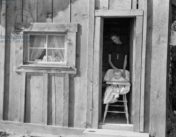 Wife and baby of president of Ola self-help sawmill co-op in Idaho, 1939 (b/w photo)