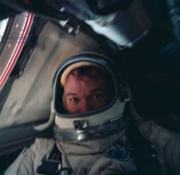 Astronaut Michael Collins is photographed inside the spacecraft during the Gemini-10 mission, 18th July 1966 (photo)