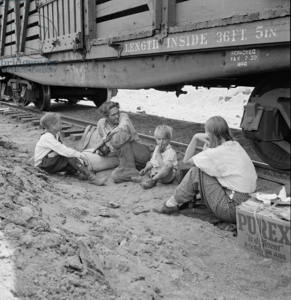 Migrant family who traveled by freight train to Yakima Valley, 1939 (b/w photo)