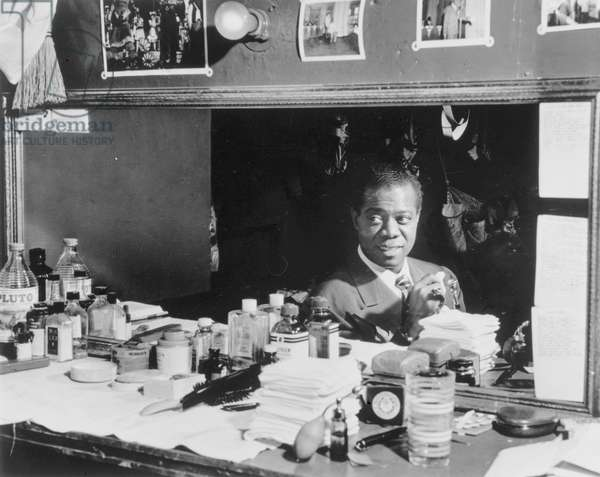 Louis Armstrong, American jazz musician in the dressing room at Aquarium in New York City, c.1946 (b/w photo)