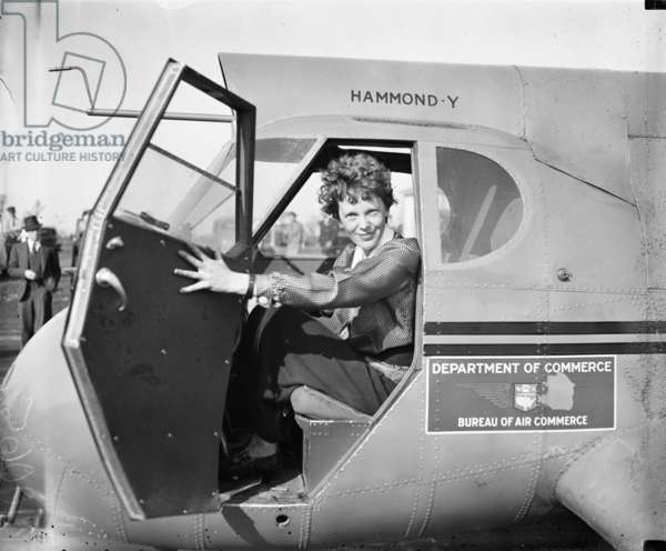 Amelia Earhart in an aeroplane, 1936 (b/w photo)