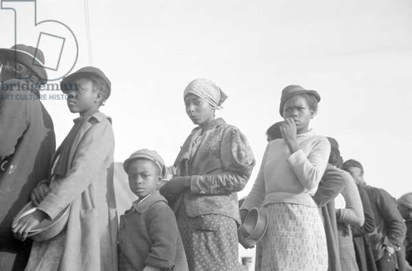 Negroes in the lineup for food at mealtime in the camp for flood refugees, Forrest City, Arkansas, 1937 (b/w photo)
