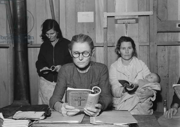 Singing hymns at Arvin camp for migrants Mothers' Club, California, 1938 (b/w photo)
