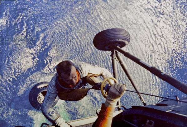 Astronaut Alan B. Shepard is hoisted aboard a U.S. Marine helicopter after splashdown of his Freedom 7 Mercury space capsule on May 5 1961 (photo)
