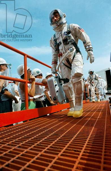 Astronauts John W. Young (leading), command pilot, and Michael Collins, pilot, walk up the ramp at Pad 19 after arriving from the Launch Complex 16 suiting trailer during the prelaunch countdown, 18th July 1966 (photo)