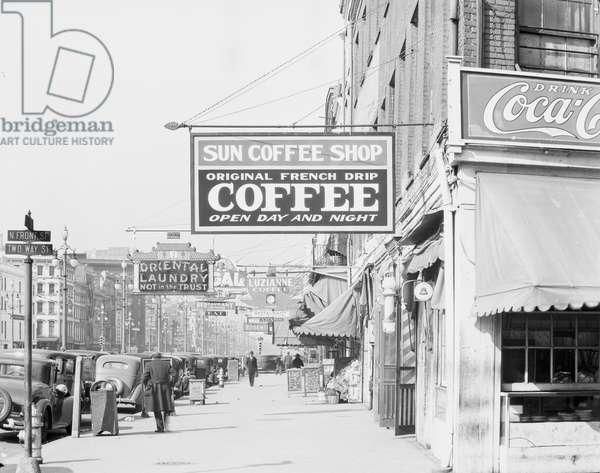 Downtown street in New Orleans, Louisiana, 1935 (b/w photo)