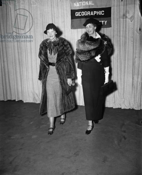 Amelia Earhart arrives with Eleanor Roosevelt to address the members of the National Geographic Society, 1935 (b/w photo)