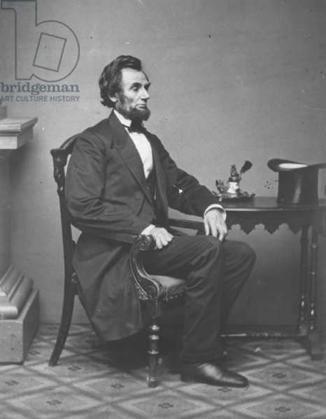 Abraham Lincoln, full-length portrait, seated, 1861 (b/w photo)