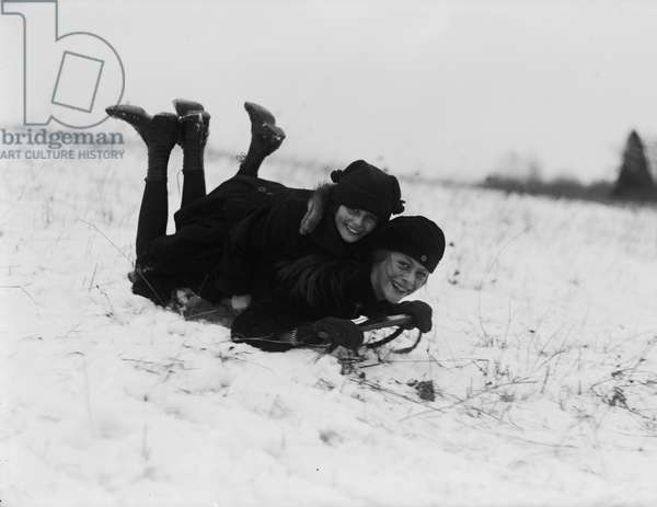 Two Smiling Girls on Snow Sled, Washington DC, USA, c.1920 (b/w photo)