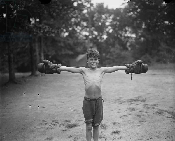 Young Boy with Boxing Gloves, 1926 (b/w photo)