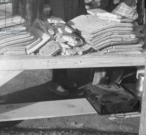 Cornbread for flood refugees at the Forrest City camp, Arkansas, 1937 (b/w photo)