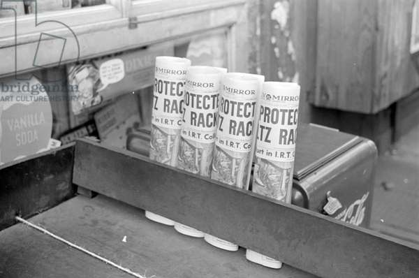 Newspapers for sale at a grocery, 324 East 61st Street, New York City, 1938 (b/w photo)