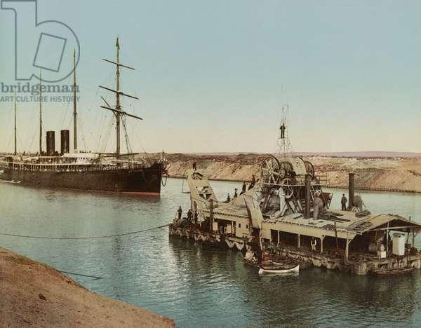 Suez Canal, ship and dredging machine, c.1900 (colour photochrom)