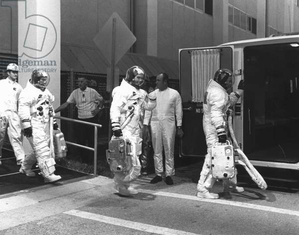 Apollo 11 crew 'suiting up' for countdown demonstration test, 1969 (b/w photo)
