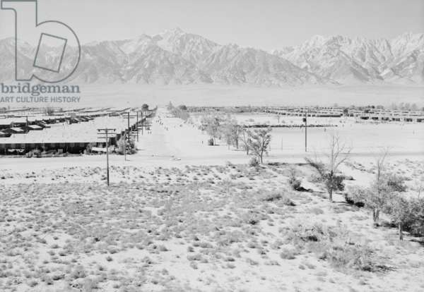 Manzanar Relocation Center from Guard Tower, view west (Sierra Nevada in background), 1943 (b/w photo)