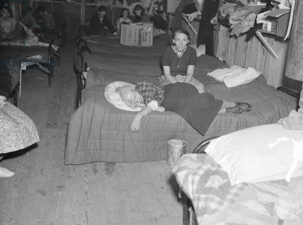 Flood refugees in canning factory used by the Red Cross as a relief station in Mayfield, Kentucky, 1937 (b/w photo)