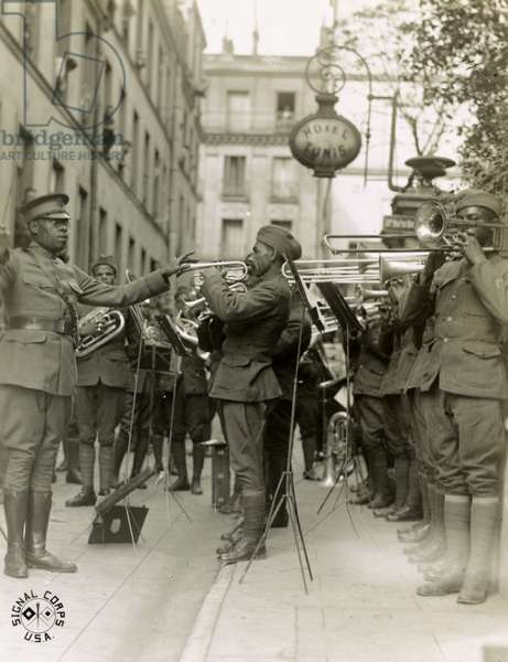 James Reese Europe and the 369th Infantry Regiment play outside an American Red Cross Hospital in Paris, 1918 (b/w photo)
