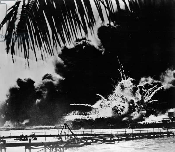 Pearl Harbor naval base and U.S.S. Shaw ablaze after the Japanese attack, 1941 (b/w photo)