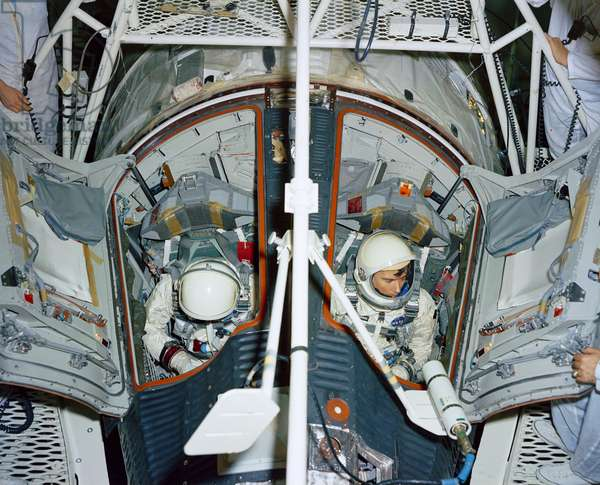 Astronauts John W. Young (right), command pilot, and Michael Collins, pilot, the prime crew of the Gemini-10 spaceflight, prepare for a Manned Altitude Test Run in the Gemini-10 spacecraft, 14th April 1966 (photo)
