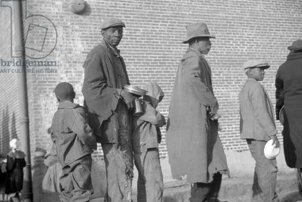 Negroes in the lineup for food at mealtime in the flood refugee camp, Forrest City, Arkansas