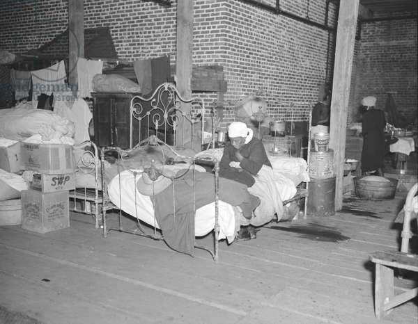 Sick Negro in the Red Cross temporary infirmary in the camp for flood refugees at Forrest City, Arkansas, 1937 (b/w photo)