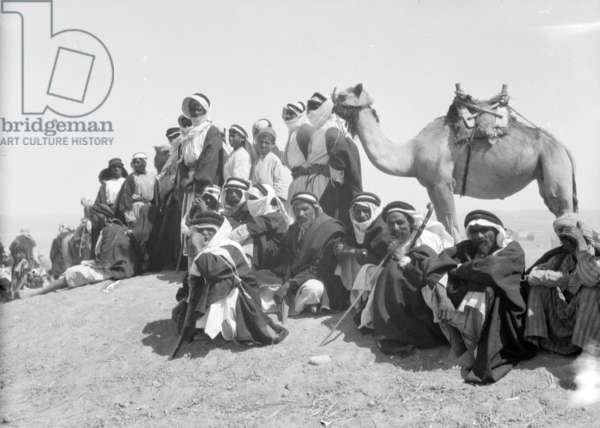 Bedouins watch the races marking the end of the locust campaign at Beersheba, June 30th, 1930.