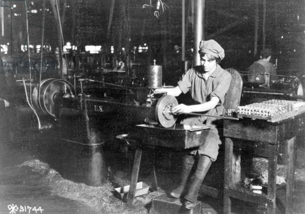 Woman broaching key seat in front sight carrier for rifle, Eddystone Rifle Plant, Eddystone, Pa., during World War I, 1914-18 (b/w photo)