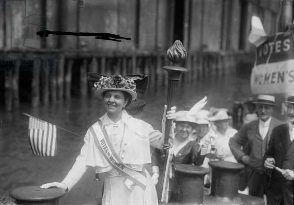 Mina van Winkle receiving the Suffrage Torch on a tugboat, 1915 (b/w photo)