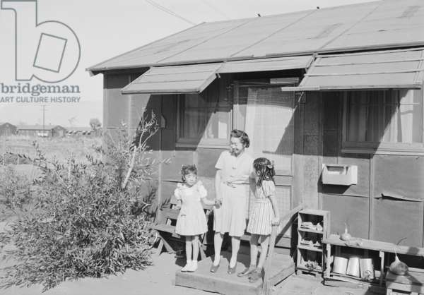 Mrs. Naguchi, with Louise Tami Nakamura and Joyce Yuki Nakamura at Manzanar, 1943 (b/w photo)
