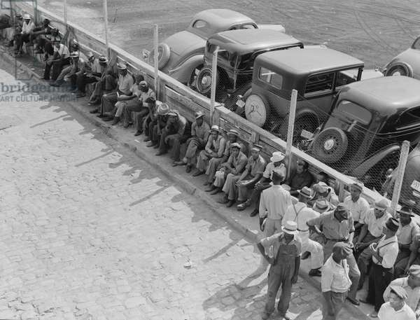 Part of the daily lineup outside the State Employment Service Office. Memphis, Tennessee, 1938 (b/w photo)