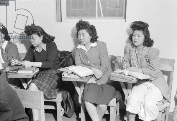 High school biology class (Kiyo Yoshida, Lillian Wakatsuki, Yoshiko Yamasaki) Manzanar Relocation Center, 1943 (b/w photo)