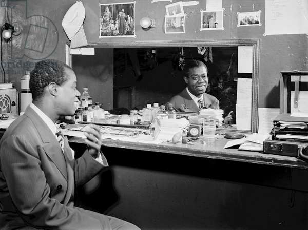 Louis Armstrong (1900-1971) American  Jazz Musician in the dressing room at Aquarium in New York City, c.1946 (b/w photo)