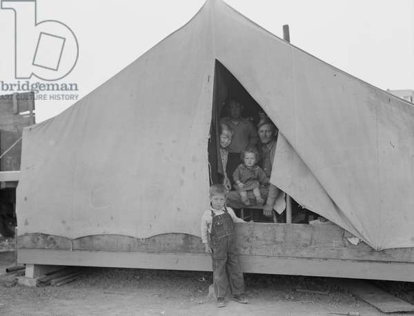 Family of mother, father and eleven children from Oklahoma in FSA labor camp, California, 1939 (b/w photo)