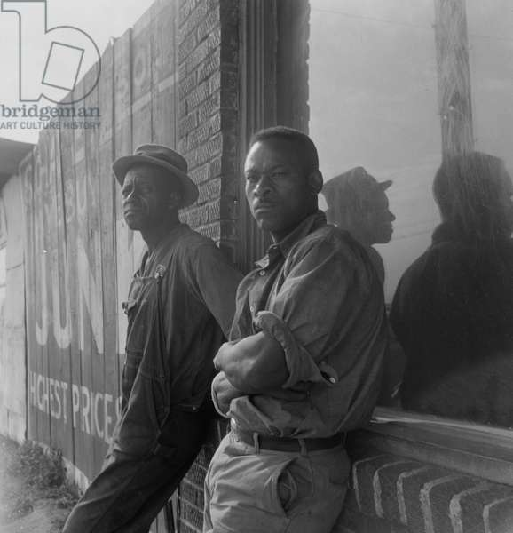 African American seasonal cotton workers hoping to be hired for a day, 1938 (b/w photo)